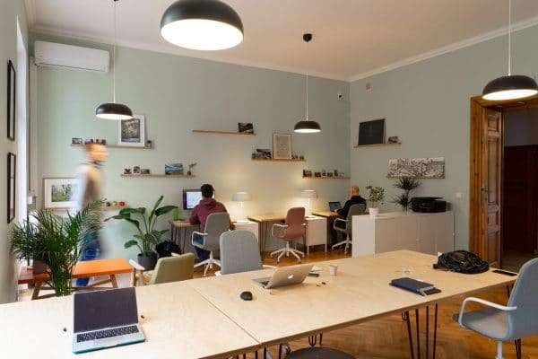 A shared office space with people from different businesses working in the same area
